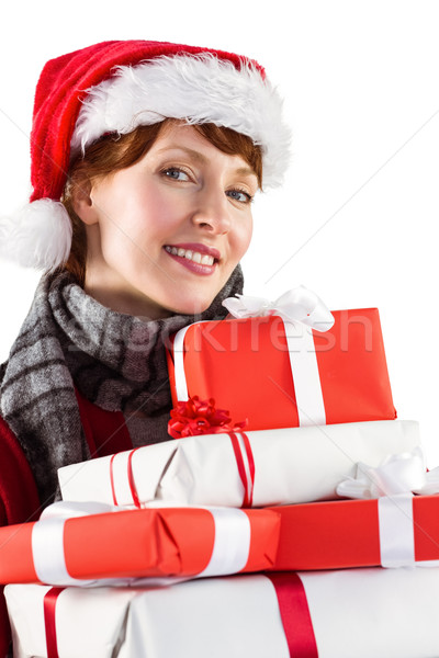 Smiling woman holding christmas presents Stock photo © wavebreak_media