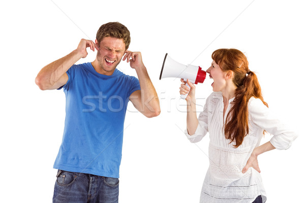 Woman shouting through a megaphone Stock photo © wavebreak_media