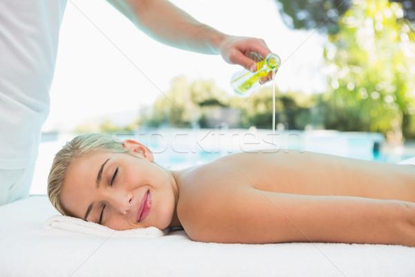 Woman receiving back massage at spa center Stock photo © wavebreak_media
