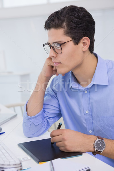 Casual graphic designer working at his desk   Stock photo © wavebreak_media