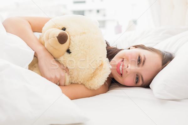 Mooie brunette teddybeer home slaapkamer gelukkig Stockfoto © wavebreak_media