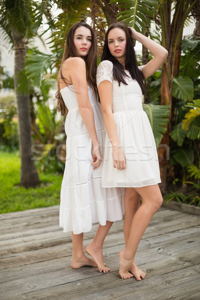Bastante amigos posando branco vestidos fora Foto stock © wavebreak_media