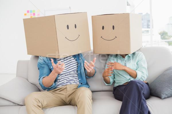 Colleagues covering their head with fun cardboard box  Stock photo © wavebreak_media
