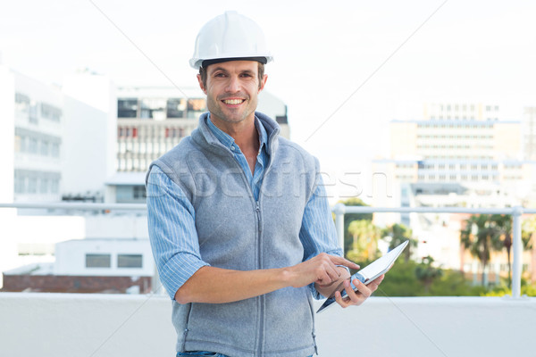 Happy male architect using digital tablet Stock photo © wavebreak_media