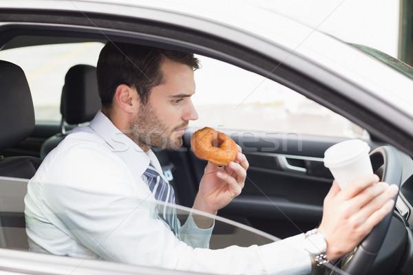Jonge zakenman koffie donut auto business Stockfoto © wavebreak_media