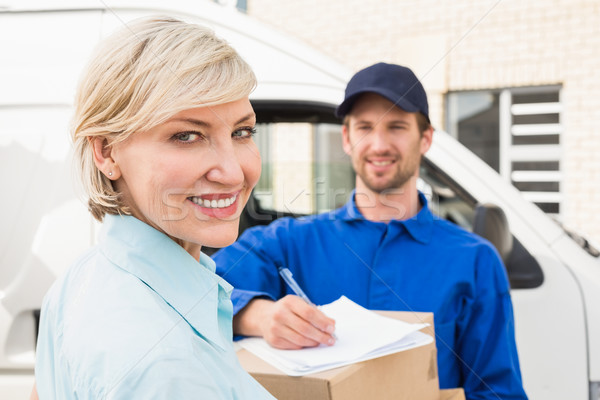 Happy delivery man with customer Stock photo © wavebreak_media