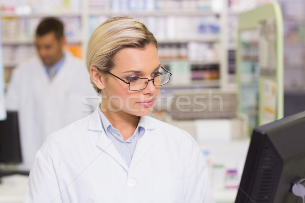 Concentrate pharmacist looking at computer Stock photo © wavebreak_media