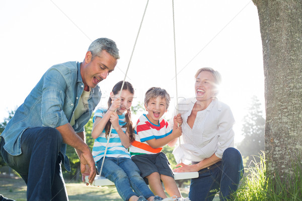 Familia feliz swing mujer árbol feliz Foto stock © wavebreak_media