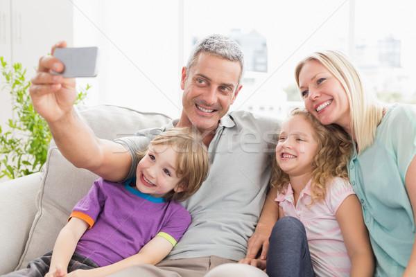 человека семьи диван счастливым домой Сток-фото © wavebreak_media