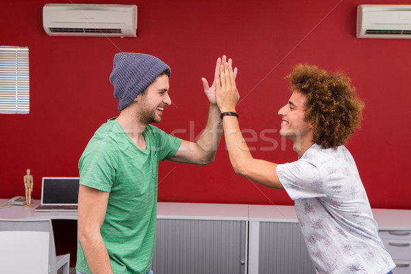 Casual young businessmen high fiving in office Stock photo © wavebreak_media