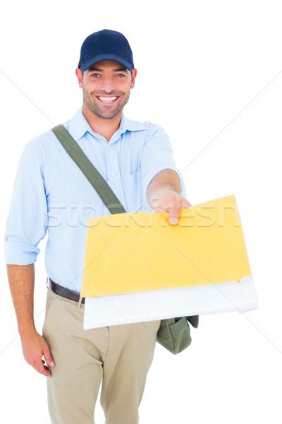 Boldog postás levél fehér portré férfi Stock fotó © wavebreak_media