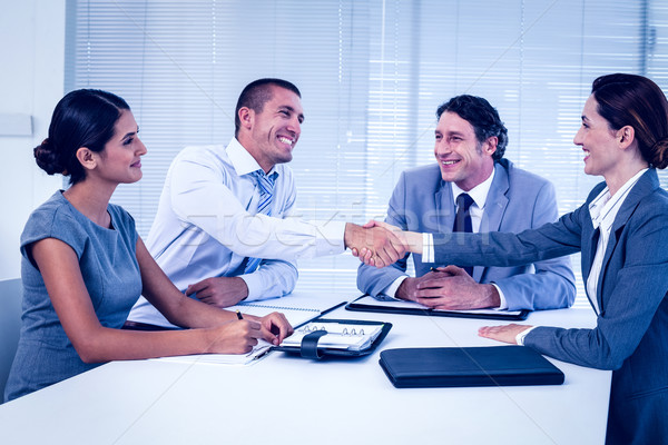 Stock photo: Business team having a meeting
