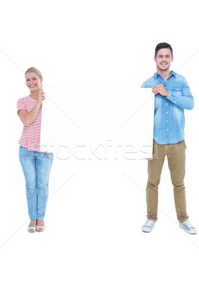 Mosolyog fiatal pér tart üres tábla fehér nő Stock fotó © wavebreak_media
