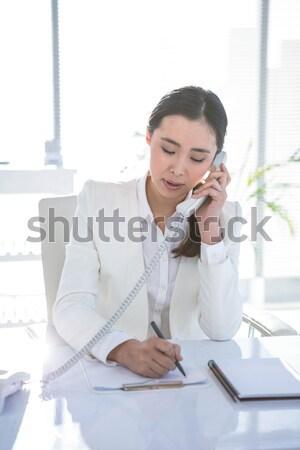 Mulher dolorido cabeça sessão para baixo Foto stock © wavebreak_media