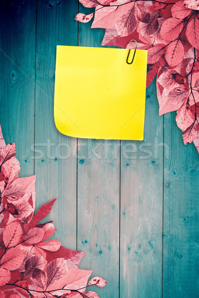 Composite image of  sticky note with grey paperclip Stock photo © wavebreak_media