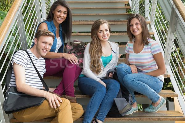 Sonriendo estudiantes sesión pasos Universidad nina Foto stock © wavebreak_media
