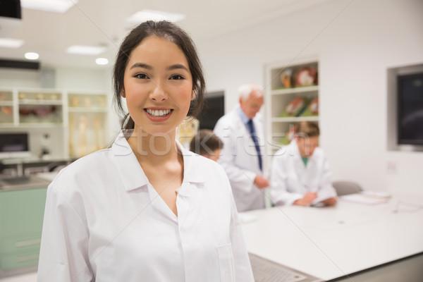Mooie wetenschap student glimlachend camera universiteit Stockfoto © wavebreak_media