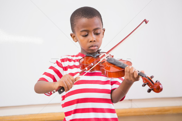 Focus pupil playing violin in classroom Stock photo © wavebreak_media