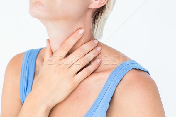 Mulher loira sofrimento garganta dor branco azul Foto stock © wavebreak_media