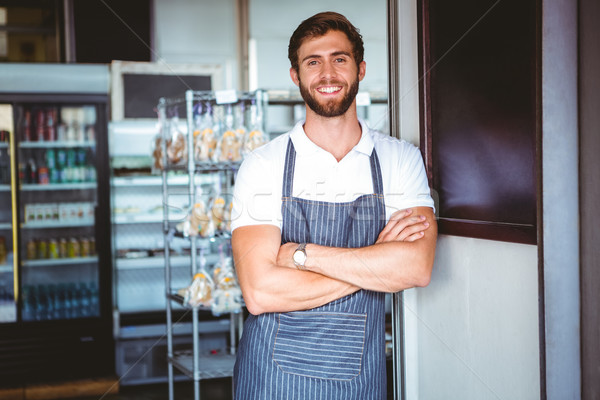 Sorridente servidor avental braço negócio comida Foto stock © wavebreak_media