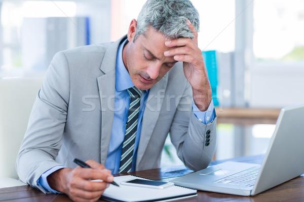 Irritated businessman trying to work  Stock photo © wavebreak_media