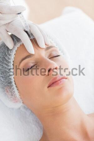 Aantrekkelijk jonge vrouw voorhoofd massage spa Stockfoto © wavebreak_media
