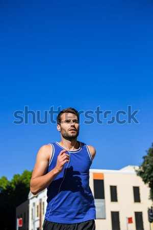 ハンサム 選手 ジョギング 青空 市 ツリー ストックフォト © wavebreak_media