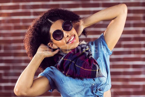 Atraente mulher jovem sentimento bom retrato vermelho Foto stock © wavebreak_media