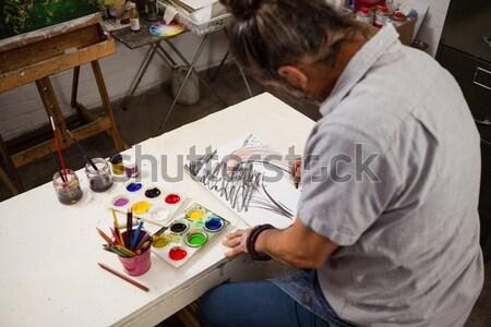 Komoly üzletember ír könyv kreatív irodai asztal Stock fotó © wavebreak_media