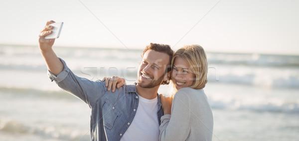 Boldog pár elvesz tengerpart napos idő nő Stock fotó © wavebreak_media