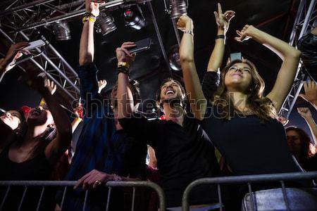 Emberek karok a magasban éjszakai klub tánc nő buli Stock fotó © wavebreak_media