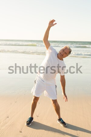 Portrait of happy senior man exercising against clear sky Stock photo © wavebreak_media