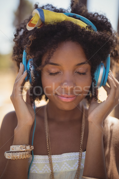 Close of young woman with eyes closed listening music Stock photo © wavebreak_media