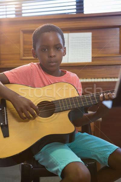 Portrait of boy playing guitar in class Stock photo © wavebreak_media