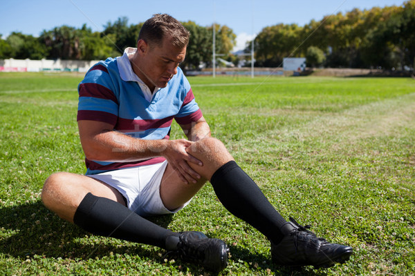 Full length of rugby player sitting on playing field Stock photo © wavebreak_media