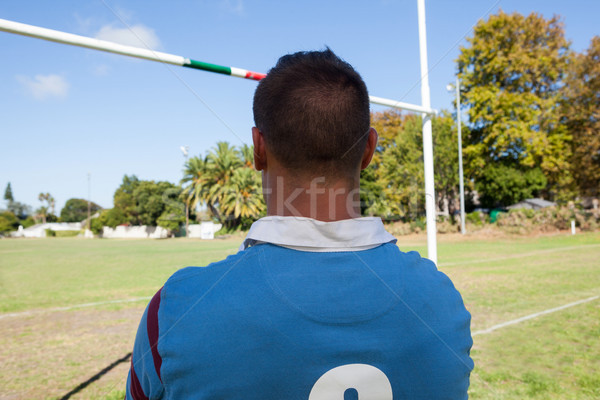 Rear view of rugby player standing against blue sky Stock photo © wavebreak_media
