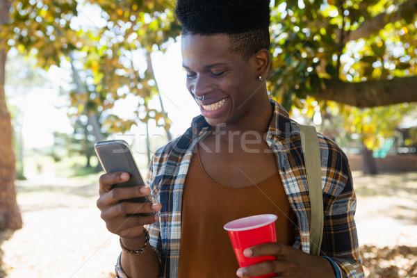 Man using mobile phone in the park Stock photo © wavebreak_media