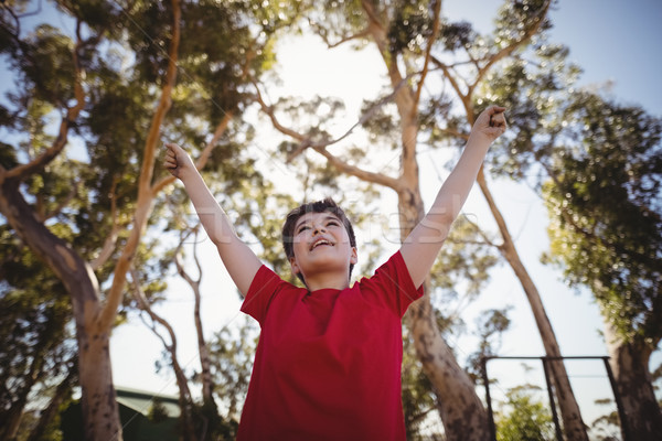 Boy cheering during obstacle course Stock photo © wavebreak_media