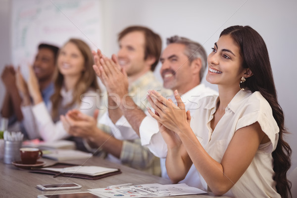 Stock photo: Business people applauding during presentation in office