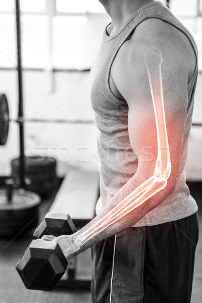 Ramię silne człowiek wagi siłowni Zdjęcia stock © wavebreak_media
