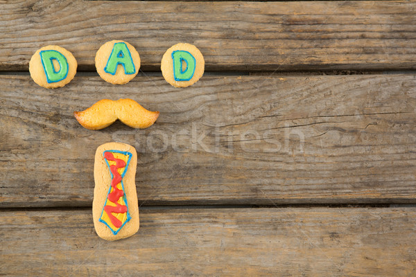 Overhead view of text decoration on cookies at table Stock photo © wavebreak_media