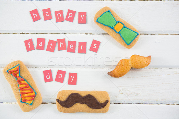 High angle view of text by cookies arranged at table Stock photo © wavebreak_media