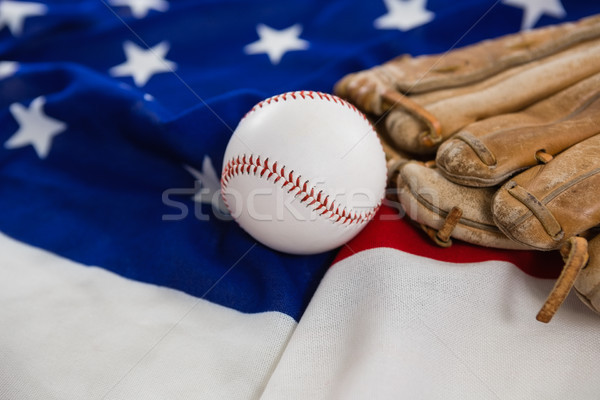 Baseball and gloves on an American flag Stock photo © wavebreak_media