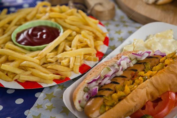 ホットドッグ フライドポテト 木製のテーブル クローズアップ 食品 ストックフォト © wavebreak_media