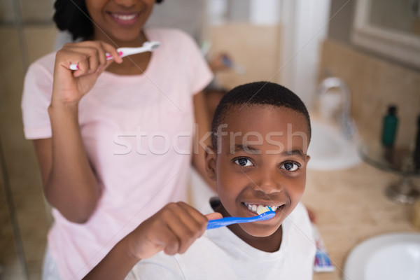 Boy with mother brushing teeth at home Stock photo © wavebreak_media