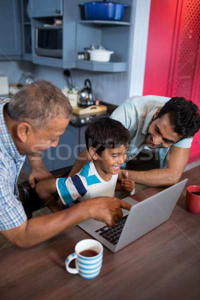 Happy father and grandfather looking at boy Stock photo © wavebreak_media