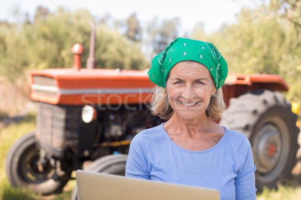 Portrait of happy woman using laptop in olive farm Stock photo © wavebreak_media