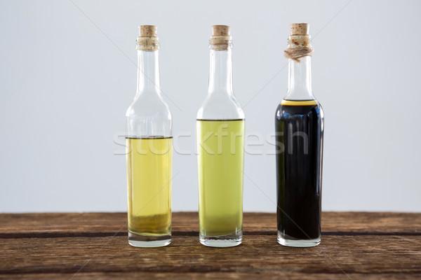Olio d'oliva aceto balsamico bottiglia primo piano tavola legno Foto d'archivio © wavebreak_media