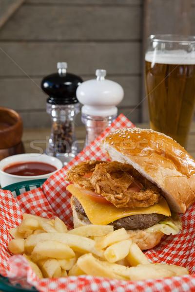 Burger patatine fritte basket tavolo in legno birra Foto d'archivio © wavebreak_media