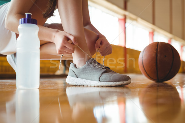 Stock photo: Close up of woman tying shoelace
